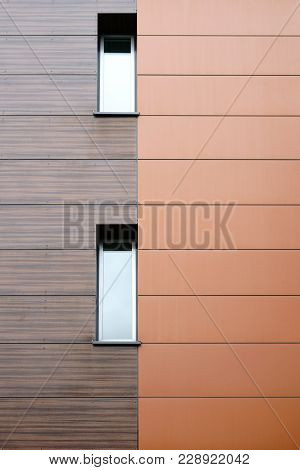 The Modern Facade Of A Building With Noble Wood Paneling.