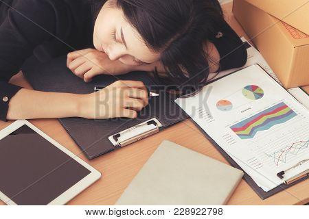 Asian Female Worker Is Sleeping On Work In Office