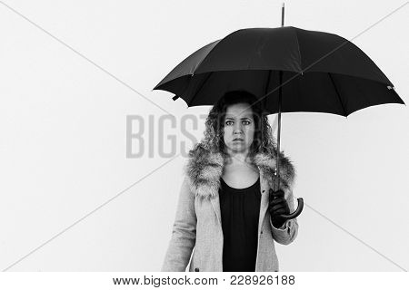 Curly Beautiful  Elegant Woman Holding Umbrella On White Background Outdoor. Black And White Photo.