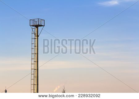 Observation Tower In An Agricultural Industrial Area.