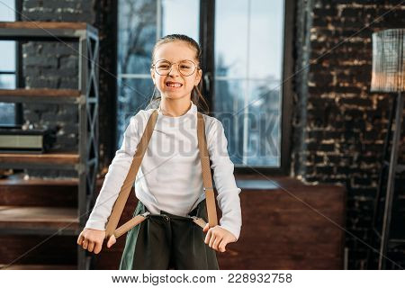 Adorable Little Child In Stylish Clothing With Suspenders