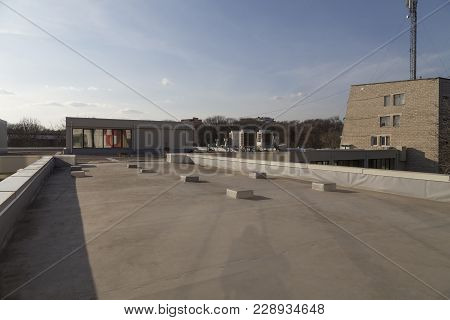 View Of The City From The Roof. Evaporators On The Roof Of The Building.