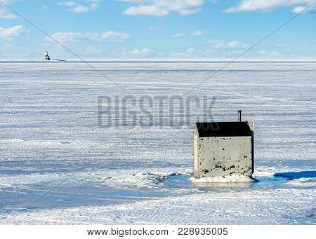 Ice fishing along the shores of Prince Edward Island.