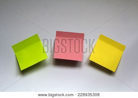 Blank Colorful Sticky Notes Isolated On White Wall Background