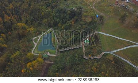 Terrace with stair. Clip. Top view of the pond with stairs to it. Well maintained pond in autumn. poster