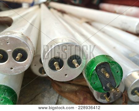 Detail Of Various Discarded And Stacked Fluorescent Lamps