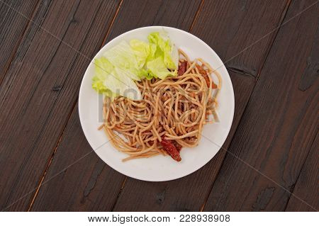 Spaghetti With Nuts And Dried Tomatoes