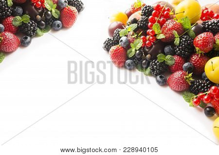 Mix Berries On A White Background. Ripe Blueberries, Blackberries, Currants, Strawberries And Yellow