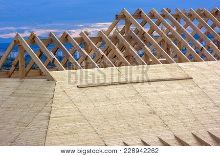 Wooden Roof. House Roof Under Construction. Roofing Construction. Wooden Roof Frame Home Constructio
