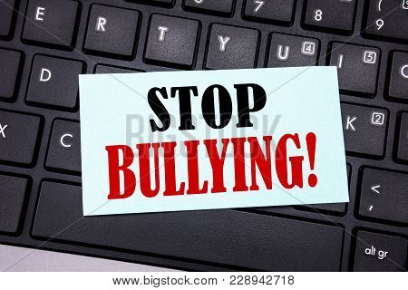 Word, writing Stop Bullying. Business concept for Prevention Problem Bully written on sticky note paper on black keyboard background. poster
