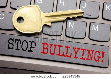Hand writing text caption inspiration showing Stop Bullying. Business concept for Prevention Problem Bully written on keyboard key on the key next to the text. poster