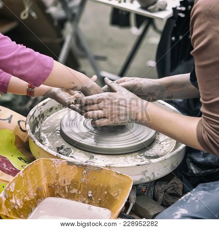 Female Hands Of Potter And Girl S Hands . Master Teaches The Student To Make Pitcher On Pottery Whee
