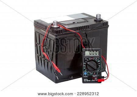 Car Battery With Digital Multimeter Isolated On White Background.