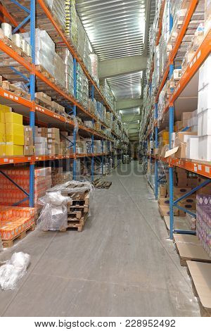 Shelves And Aisle In Food Distribution Warehouse