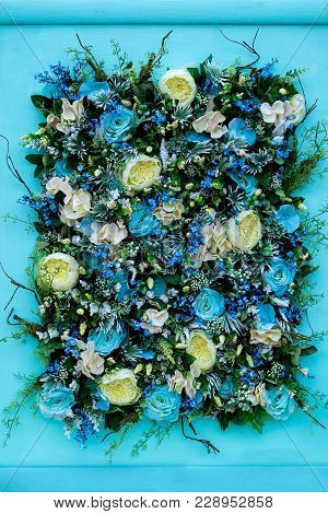 Colorful Flower Arrangement Of Blue Roses, Greenish-white Ranunculus, Other Flowers, Leaves And Root