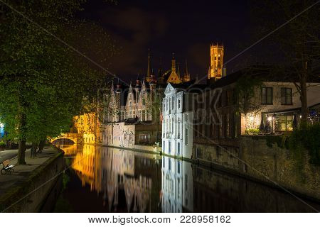 Bruges, Belgium - April 17, 2017: Night View Of Bruges City, Belgium, Nightshot Of Brugge Canals, Tr