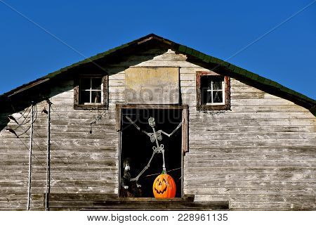 The Hay Loft Door  Opening Of An Old Abandoned Barn Has Been Converted Into A Halloween Scene With A