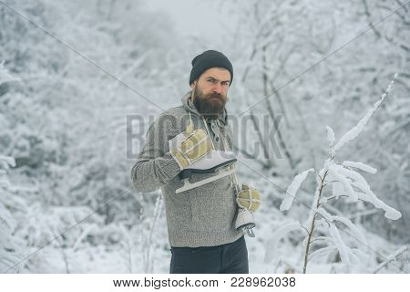Winter Sport And Rest, Christmas. Bearded Man With Skates In Snowy Forest. Temperature, Freezing, Co