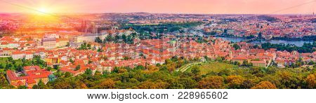 Sunset In Prague, Aerial view of the Old Town and Charles Bridge over Vltava river in Prague, Czech Republic /  Panoramic Shot Of Old Town And City Center In Prague