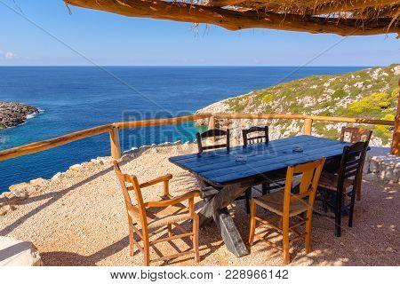 Greek Tavern On Cliff With View Of Blue Sea Water. Zakynthos Island. Zante, Greece
