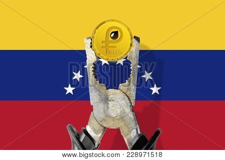 Petro (ptr) Coin Being Squeezed In Vice On The Venezuelan Flag Background; Concept Of Cryptocurrency