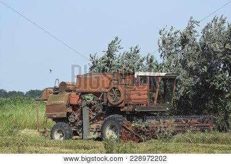 Poltavskaya Village, Russia - September 6 2017: Old Rusty Combine Harvester. Combine Harvesters Agri
