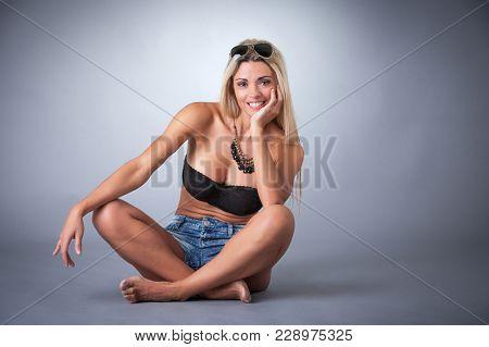 beautiful girl in shorts in studio