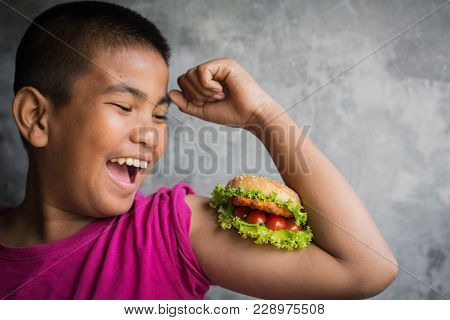 Portrait Asian Fat Boy Enjoy Eating With Hamburger, Concept Healthy And Lose Weight ,selective And S