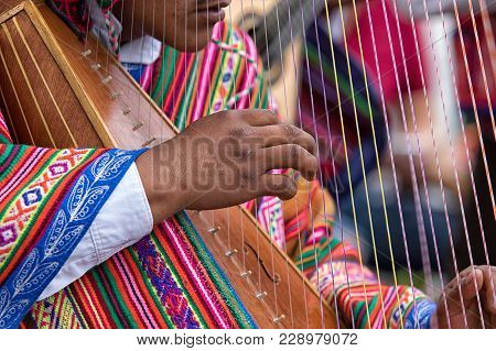 Otavalo, Ecuador - February 17, 2018: Hand Of A Peruvian Indigenous Musician Playing The Harp In The