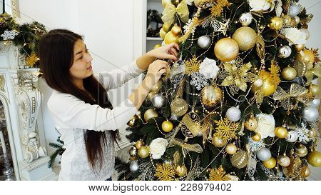 Gorgeous Girl In New Year's Mood Finishes Decorating Christmas T