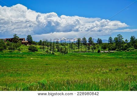 Clouds Above Colorado Mountains And Green Pasture Near Mesa Verda National Park