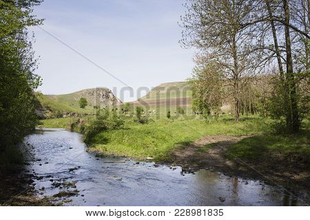 Great Landscape With The River And The Dirt Road. The Dirt Road Is Going Out Of The Stream.