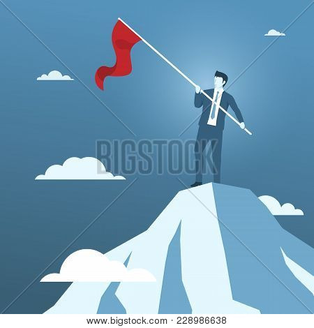 Businessman Holding Red Flag On The Top Of Mountain, Concept Of Business Success Or Business Conquer