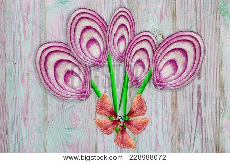 Unusual Bouquet Of Cut Slices Of Red-purple And Green Onions With Husk On Wooden Background, Top Vie