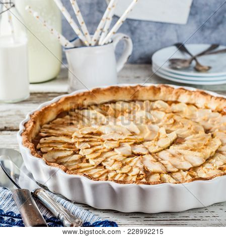 Whole Round Toffee Apple Tart In A White Ceramic Pan, Square