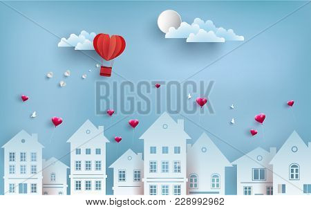 Air Balloons Flew Over A House In Town. Symbol Of The Love Of A Hot Air Balloon. Paper Art Design