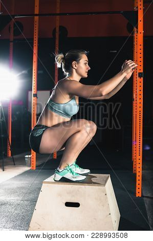 Active People Sport Workout Concept. Attractive Woman Do Sit-ups Exercises. Workout Exercise At Gym