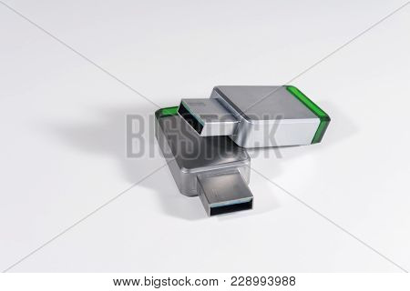 Usb Flash Drives In A Metal Case. On A White Background.