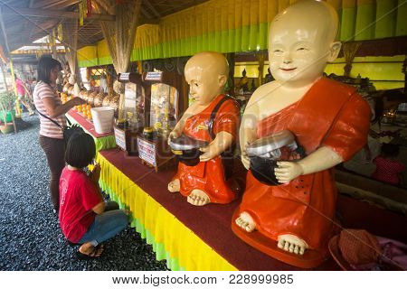 KOH CHANG, THAILAND - MAR 1, 2018: Celebration of Makha Bucha Day. One of the three most important holidays of Buddhism, which dictates its social norms to local residents and foreign tourists.