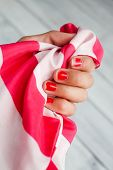 Not well- groomed hand demanding manicure .Not well-groomed female nails, with red varnish. poster