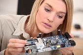 woman repairing pc poster