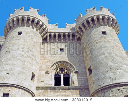 The Front Of The Medieval Palace Of The Grandmasters In Rhodes Town Against A Blue Summer Sky