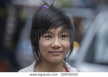 Ho Chi Minh City (saigon), Vietnam - March 02, 2011: Cute Young Vietnamese Girl With Asian Modern Ha