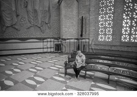 Aparecida, São Paulo, Brazil - January 13, 2016:  Brazilian Woman Prays At Cathedral Of Nossa Senhor