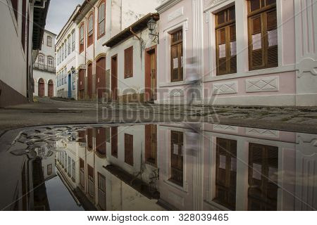 Sao Joao Del Rei, Minas Gerais, Brazil - March 05, 2016: Reflection In Puddle Water Of A Street In T