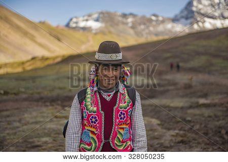 Vinicunca, Cusipata, Peru - June 08, 2017: Peruvian Andean Man Wearing Traditional Colorful Clothing