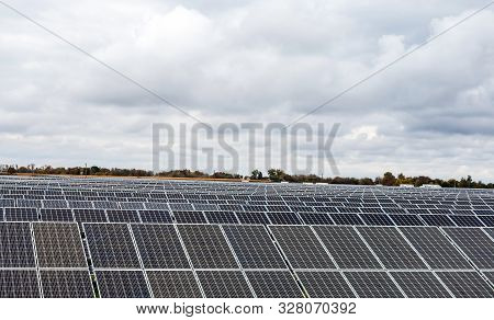 Sections Of Solar Panels On The Blue Sky Background
