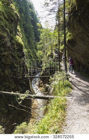 Narrow Mountain Canyon With River. People - Hikers On Pedestrian Path Along Gorge. Juráňová Valley (