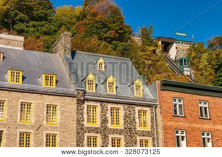 Quebec City, Canada - 4 October 2019: Traditional Stone Houses On Boulevard Champlain With The Funic