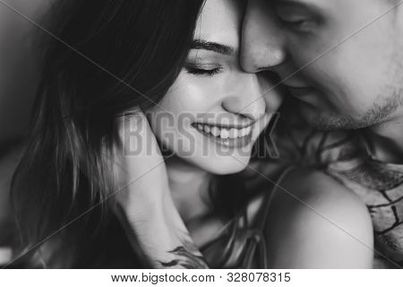 Kissing Couple Portrait. Young Couple Deeply In Love Sharing A Romantic Kiss. Black And White Photo